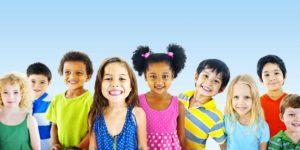 Nine Happy Kids of all ethnicities smiling