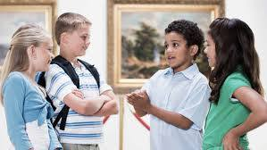 two girls and two boys talking
