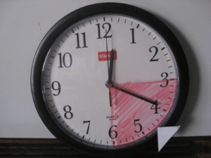 analog clock with three to six shaded in red