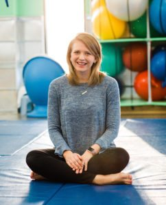 Brittni Winslow, executive director of Emerge Pediatric Therapy seated in sensory gym