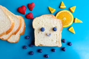 bread with blueberry eyes and smile, orange sunshine and strawberry hearts