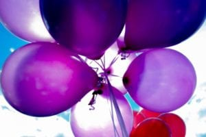 Purple, blue, and red balloons