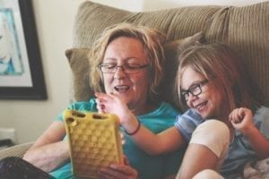 Mother and daughter using a tablet together