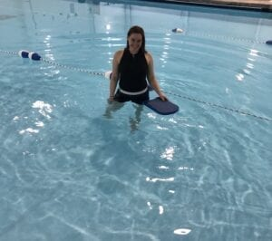 Occupational Therapist Alexa at the pool providing Aquatic Therapy