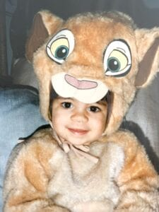 Speech-language pathologists Megan as a young girl in a Lion King costume