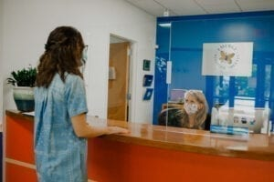 Receptionist greeting a guest at Emerge Pediatric Therapy