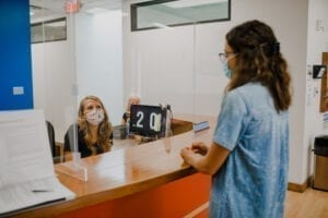 Receptionist greeting a guest