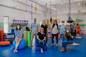 Emerge Pediatric Therapy Staff posing while all wearing masks, in the Sensory Gym