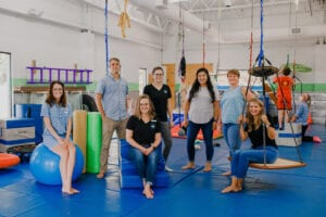 Emerge Pediatric Therapy Staff posing in the Sensory Gym