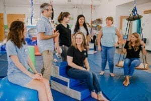Emerge Pediatric Therapy Staff posing and interacting in the Sensory Gym