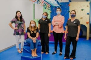 Staff of Emerge Pediatric Therapy inside the Cary Sensory Gym
