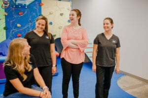 Staff of Emerge Pediatric Therapy interacting inside the Cary Sensory Gym