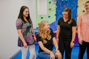Staff of Emerge Pediatric Therapy interacting