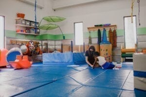 Therapist and child working in the Emerge Pediatric Therapy Sensory Gym