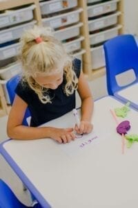 Girl practicing hand writing and visual motor skills in the Fine Motor Room