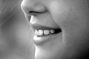 black and white close up image of a mouth and nose in profile