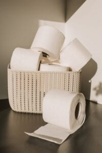 white braided basket of toilet paper