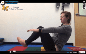 female therapist sits in yoga boat pose on a colorful mat