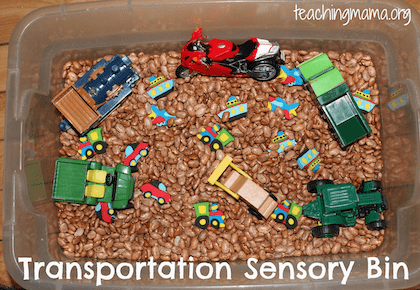 Transportation Sensory Bin filled with Beans and Trucks